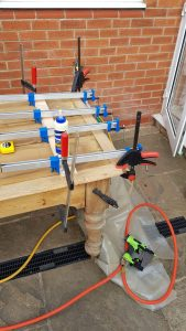 clamping and fixing the oak edging to this antique pine table